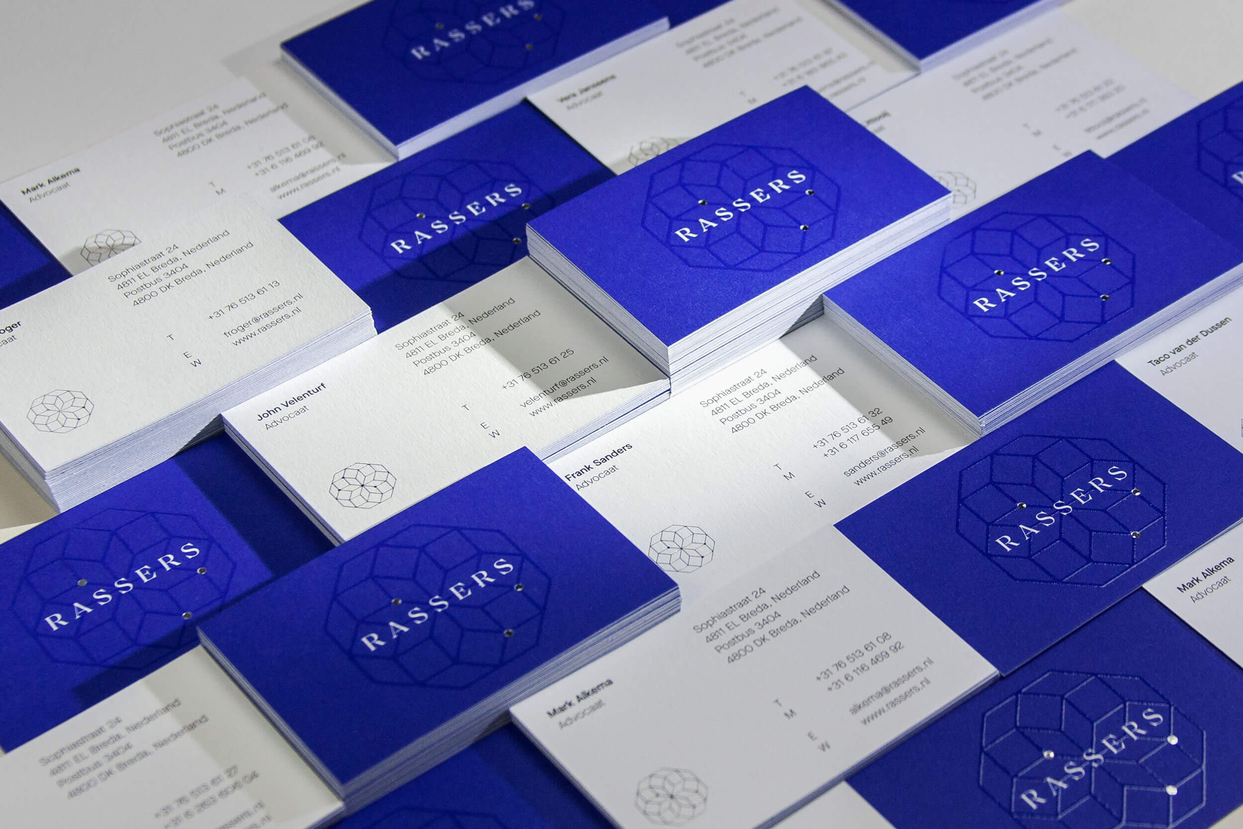 A couple stacks of Rassers business cards design